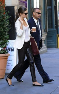 Miranda Kerr wearing a Celine Cabas tote, Mac Jacobs classic jelly flats, & Louis Vuitton Iconic leather treggings.