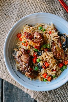 Rice Cooker Ribs and Rice: Feel free to use chicken instead of pork, add more vegetables, or make your own version by using this recipe as a guideline. I hope this recipe will germinate many more great one-pot meals for you and your family. Just let your rice cooker do most of the work.   The Woks of Life