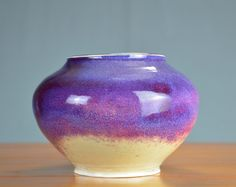 Beautiful Purple Porcelain Vase  Hand thrown by Shelly Caldwell in her mountain top studio in Park City  Creation Process: 1. Hand thrown porcelain on a potters wheel 2. Hand trimmed and bisque fired (1st kiln firing) 3. Hand glazed - Lipstick purple glaze 4. High Fired (2nd kiln firing to 2381 degrees) - Making these very durable and difficult to chip or break  Great for: -Fresh Flowers -Dried Flowers -Kitchen Storage -Bathroom Storage  *Dishwasher safe *Oven Safe *Microwave safe *Food…