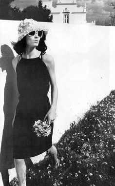 Carefree in blooms and an LBD in British Vogue, May 1965, by Helmut Newton