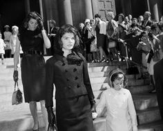 Jacqueline Kennedy and her daughter, Caroline, leave The Capitol after a service there on November 24, 1963