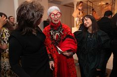Iris Apfel (L-R) Erickson Beamon jewelry designer Vicki Beamon, Iris Apfel  and Erickson Beamon jewelry designer Karen Erickson pose for photos with dancers from the Bolshoi Ballet Academy United States Youth Program during the Erickson Beamon Fall/Winter 2011 Presentation at Milk Studios on February 13, 2011 in New York City.