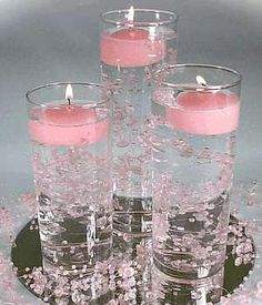 Diy wedding centerpieces pearls floating candles 27 new ideas Non Flower Centerpieces, Candle Wedding Centerpieces, Centerpiece Ideas, Candle Decorations, Sweet 16 Centerpieces, Water Beads Centerpiece, Pink Party Decorations, Graduation Centerpiece, Flowers Vase