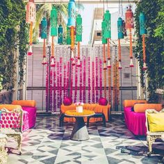 Kitschy and fun mehendi decor inspiration | Colorful hanging lanterns and flower chains | Marigold flower decor | Yellow and pink mehendi decor | DIY mehendi decor ideas | Styled by With Love Nilma | Every Indian bride's Fav. Wedding E-magazine to read. Here for any marriage advice you need | www.wittyvows.com shares things no one tells brides, covers real weddings, ideas, inspirations, design trends and the right vendors, candid photographers etc.