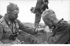 German soldiers smoking a cigarette. Location near Pokrowka, Russia, June 1943 - Kursk salient, this was the turning point after the earlier defeat at Stalingrad. Kursk was a defeat the Germans never recovered from.