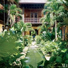 Designer Juan Montoya devised this hacienda-style beach house in the Dominican Republic for Venezuelan clients. Crisscrossing jets of water in the courtyard's fountain mimic those at Spain's Alhambra palace.
