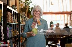 Stock-Foto : Caucasian woman holding ball of yarn in shop