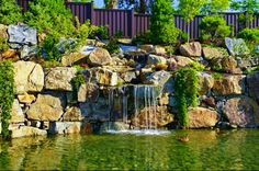 Trex Fencing can be that last addition to your backyard to be the best backyard in the neighborhood. Notice the combination of the waterfall, Trex Fencing, and of course the ducks. Trex Fencing, Composite Fencing, Fence, Pond Rocks, Stone Water Features, Rock Wall, Cool Landscapes, Landscape Design, Woodland