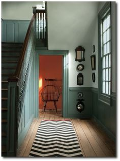 Favorite Paint Colors ~ The New Williamsburg Collection from Benjamin Moore Benjamin Moore's Williamsburg Collection >> All colors using Aura Interior, Matte Finish: Palace Pearl (walls), Wythe Blue (stairs & wainscoting) and Claret (back hall). Wainscoting Stairs, Painted Wainscoting, Dining Room Wainscoting, Wainscoting Bathroom, Wainscoting Ideas, Black Wainscoting, Wainscoting Height, Rustic Wainscoting, Wythe Blue