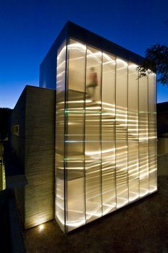 the volumetric composition and the materials of the house produce cool lighting effects