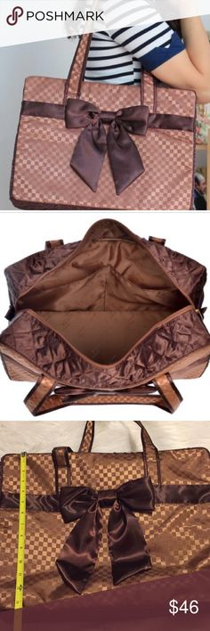Large satin travel bag Cute Checkered brown on brown pattern Beautiful Satin Brown Bow on the front of the bag 2 open pockets inside bag Zip closure Double soft handles Great condition Naraya Bags Travel Bags