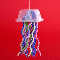 Recycle a plastic container to make a colorful jellyfish. Night of the Moonjellies, FIAR.