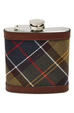 Keep your favorite libation close at hand with a stainless-steel hip flask featuring classic tartan checks and refined leather trim. http://barbour.uk/TartanHipFlask
