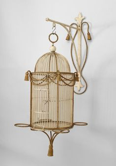 Italian 1940s rope and tassel design white and gold painted birdcage with cylindrical design and suspended by an optional wall bracket. Definite wow factor.