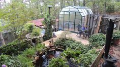 Grandio Elite Greenhouse in Georgia. Such a great garden and pond design.
