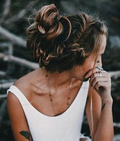 messy hair. braids. white top. tattoos. boho jewelry.