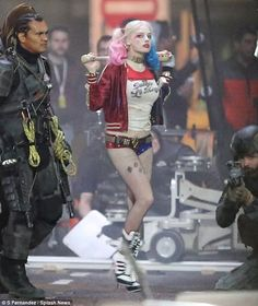 Daddy's Little Monster! Margot Robbie transforms into colorful Harley Quinn as she's seen on Suicide Squad set for first time