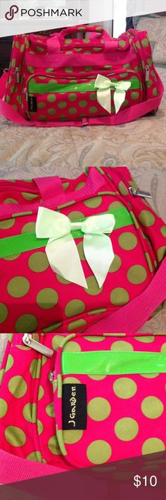 J Garden duffle bag. J Garden duffle bag.,bright pink and lime green ,inside is clean,slight wear on inside flap otherwise is in great condition. Measures 19 inches in length. J Garden Bags
