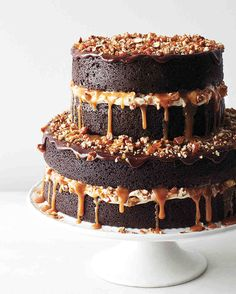 This cake is a chocolate lover's dream. Layers are filled with buttercream, drizzled with caramel and chocolate ganache, then topped with glistening candied pecans. The cake gets moisture from butter, yogurt, and stout--though craft beer fans can customize with local chocolate-friendly brews.