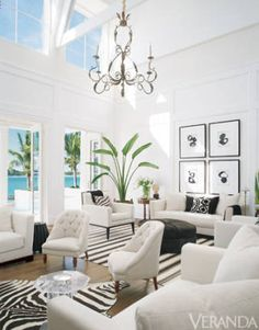 Animal print and black and white striped rugs add pattern to this all-white room.