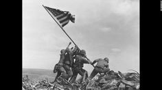 This iconic photo, taken February 23, 1945, by Associated Press photographer Joe Rosenthal, shows five U.S. Marines and a Navy sailor raising the American flag over the battle-scarred Japanese island of Iwo Jima. But it wasn't the first flag raised over Iwo Jima that day, and Rosenthal wasn't the only one there taking photos.