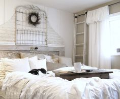 how to create your own headboard from junk, bedroom ideas, crafts, doors, home decor, repurposing upcycling, An old gate and door trimmed out with some painted metal siding became part of a whimsical shabby retreat for this white bedroom makeover Visit post at