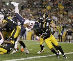 Chicago Bears running back Matt Forte (22) goes in for a touchdown over Pittsburgh Steelers free safety Ryan Clark (25). (AP Photo/Gene J. Puskar)