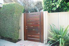 Custom Wood Gates by Garden Passages Premium Wood Gates  Features: Horizontal Body Premium Stain Thick Body Emtek Hardware Heavy Duty Hinges  See More at: http://www.gardenpassages.com/premium-wood-gates