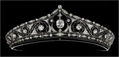 Diamond tiara, by André Falize, Paris, Mellerio dits Meller. The tiara is platinum and set with brilliant cut diamonds. It dates from 1911 and bears the signature of Andre Falize, Paris.