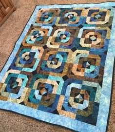 Log cabin flying geese quilt using Missouri Star Quilt Company tutorial.