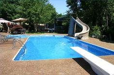 Backyard pools with diving boards | diving board can be a great addition to your backyard pool, but ...