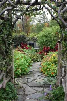 Flagstone path leading to a quiet garden alcove with bench...