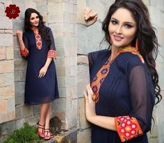 Very Elegant Looking Navy Blue Georgette Kurti with beautiful thread Embroidery on neckline. Comes with santoon innner and is available in L, XL, XXL size.