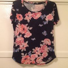 Download the Postmark app to buy my Old Navy floral t-shirt Signs of wear from washing, shown in picture 2. Size M, fits like a S. Fitted short sleeve t-shirt. Old Navy Tops Tees - Short Sleeve