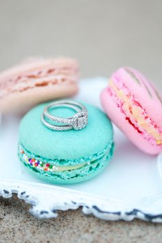 Has got to be one of my fav ring shots of all time!  Diamond halo ring on pastel colored macaroons.