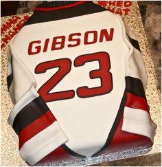 Hockey Jersey Cake - Chocolate cake covered in fondant.  Name and numbers cut using my Cricut Cake.