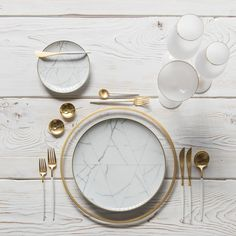 Halo Glass Chargers in 24k Gold + Carrara Dinnerware + Goa Flatware in Brushed 24k Gold/White + 14k Gold Salt Cellars + Tiny Gold Spoons SHOP: Halo Glass Chargers in 24k Gold + Carrara Dinnerware + Goa Flatware in Brushed 24k Gold/White + Bella 24k Gold Rimmed Stemware in White + 14k Gold Salt Cellars + Tiny Gold Spoons