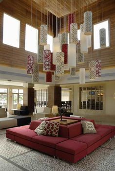 The main reception area revolves around a central wooden 'shokhshekha' - Islamic architectural term for lantern skylight - clad in horizontal slats of wood.