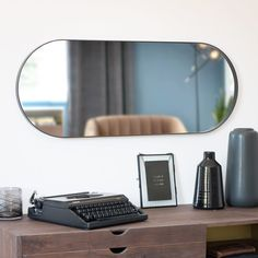 Black Metal Mirror on Maisons du Monde. Take your pick from our furniture and accessories and be inspired! Black Metal, Metal Shelving Units, Sun Lounger Cushions, Basin Unit, Unique Mirrors, Decorative Storage Boxes, Lantern Candle Holders, Metal Mirror, Small Furniture
