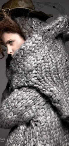 +++Knit One Purl One - so...I love big, chunky sweaters, wraps or whatever...but this looks like the model is emerging from a cocoon or swallowed whole...
