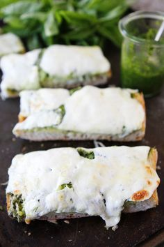 Pesto Cheese Bread Recipe on http://twopeasandtheirpod.com Love this easy bread!