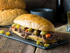 These Crock Pot Italian Beef Sandwiches are done right, Chicago style! Each tender sandwich is infused with Italian seasonings and served on a hoagie dripping with juice and loaded with crunchy giardiniera!