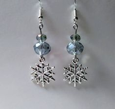This is a pair of silver tone Snowflake drop earrings with pale blue rondelle crystals. They dangle inches long from their silver plated hook. These earrings are perfect for the Winter holidays or even for a Christmas in July Diy Christmas Earrings, Holiday Jewelry, Bead Jewellery, Beaded Jewelry, Jewelery, Pearl Jewelry, Homemade Jewelry, Bijoux Diy, Diy Earrings