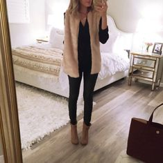 I don't know about the vest, but nice dark outfit and boots!  A Spoonful of Style: October 2015