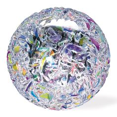 Dichroic glass glistens on the shard like surface of this unique paperweight.