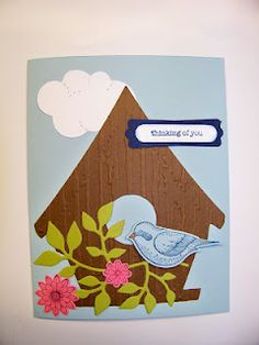 I just recently purchased the bird house sizzix die and thought I would post the card I made with it as it compliments Stampin' Up!s bird building stamps and punch so well.  I used a cuttlebug wood grain embossing folder on the bird house which I thought really improved the overall appeal of the card.  I used Stampin' Up's Thinking of You stamp from the Teeny Tiny Wishes set, but any sentiment could be used.