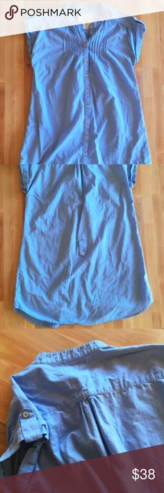 Urban Outfitters Button Up Tunic Sweet and subtle are the words of the day in this wonderful tunic from Urban Outfitters. Feels like 100% Cotton. Comes with matching ribbon tie for around the waist. Epaulets on rolled sleeves and intricate detailing throughout. Light blue. EUC. Urban Outfitters Tops Tunics