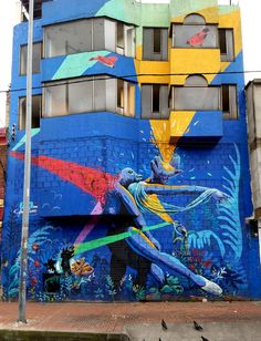 Bogotá Colombia - Street Art & Graffiti – This is from the tougher Barrio Santa Fe neighborhood of Bogotá.  The street art in the Barrio is incredible. The street art and graffiti is on par with the best in the world.  World class artists have come to Bogotá!  Original Photography by R. Stowe.