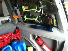 Fire extinguisher, hi-lift jack, shovel/axe, etc tool mounts in rear cargo...