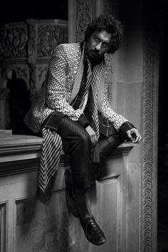 A dust and black silk jacket over a wool felt shirt with Gaudi silk pants, a black and ivory striped cotton scarf, and Visconti python shoes HAIDER ACKERMANN